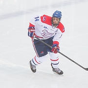 Joe Pendenza #14 of the UMass Lowell Riverhawks in action during the Frozen Fenway game between The Northeastern Huskies and The UMass Lowell Riverhawks at Fenway Park on January 11, 2014 in Boston, Massachusetts.