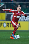 Wisla's Lukasz Gargula controls the ball during T-Mobile ExtraLeague soccer match between Legia Warsaw and Wisla Krakow in Warsaw, Poland.<br /> <br /> Poland, Warsaw, March 15, 2015<br /> <br /> Picture also available in RAW (NEF) or TIFF format on special request.<br /> <br /> For editorial use only. Any commercial or promotional use requires permission.<br /> <br /> Mandatory credit:<br /> Photo by © Adam Nurkiewicz / Mediasport