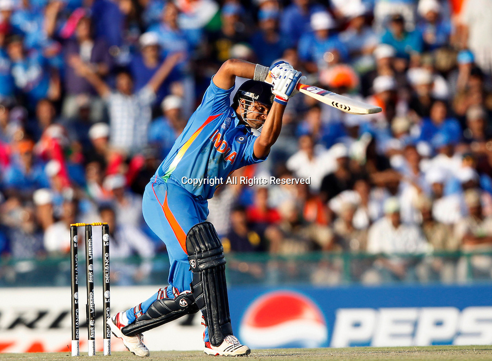 30.03.2011 Cricket World Cup from the Punjab Cricket Association Stadium, Mohali in Chandigarh. India v Pakistan.Suresh Raina of India plays a shot during the match of the ICC Cricket World Cup between India and Pakistan.