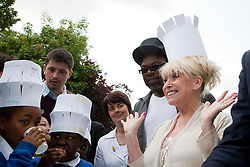© under license to London News Pictures.  19/05/2011. LONDON, UK. Photocall for The Big Lunch. Barbara Windsor calls on Londoners to catch the street party fever. The Big Lunch is an annual one-day get together where neighbours and local communities share lunch and enjoy a street party. Last year, 800,000 people took part across the UK, over 160,000 of which were in London. Photo credit should read Bettina Strenske/LNP