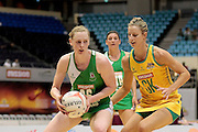 05.07.2011 Noleen Lennon of Northern Ireland(left) looks for passing options while Laura Geitz closes her down during the Pool A match between Australia and Northern Ireland, Mission Foods World Netball Championships 2011 from the Singapore Indoor Stadium in Singapore.