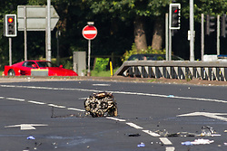 © Licensed to London News Pictures . 22/06/2014 . Manchester , UK . The engine , believed to have come from the Corsa , lies in the road . Fatal RTA scene in Manchester where a man has died in a three vehicle collision on the East Lancs Road (A580) this afternoon (Sunday 22nd June 2014) . An Audi RS3 and an Audi S3 were travelling eastbound along the A580 when they collided with a Vauxhall Corsa , near to the Swinton Park area . The male driver of the Corsa suffered multiple injuries and was pronounced dead at the scene . A woman passenger also suffered serious injuries and has been taken to hospital in a critical condition . The drivers of the Audis - two men - are under arrest on suspicion of causing death by dangerous driving and are in police custody . Photo credit : Joel Goodman/LNP