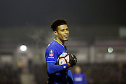 AFC Wimbledon striker Lyle Taylor (33) holding the ball during the The FA Cup third round replay match between AFC Wimbledon and Sutton United at the Cherry Red Records Stadium, Kingston, England on 17 January 2017. Photo by Matthew Redman.