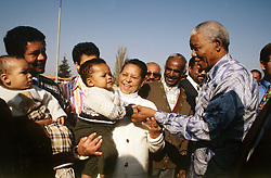 NELSON ROLIHLAHLA MANDELA (July 18, 1918 - December 5, 2013), 95, world renown civil rights activist and world leader. Mandela emerged from prison to become the first black President of South Africa in 1994. As a symbol of peacemaking, he won the 1993 Nobel Peace Prize. Joined his countries anti-apartheid movement in his 20s and then the ANC (African National Congress) in 1942. For next 20 years, he directed a campaign of peaceful, non-violent defiance against the South African government and its racist policies and for his efforts was incarcerated for 27 years. Remained strong and faithful to his cause, thru out his life, of a world of peace. Transforming the world, to make it a better place. PICTURED: 1994 - South Africa - NELSON MANDELA is greeted jubilantly by supporters in  during his electrion campaign that spanned the country and saw him win the first ever democratic non-racial elections in South Africa.  (Credit Image: © Greg Marinovich/ZUMA Wire/ZUMAPRESS.com)