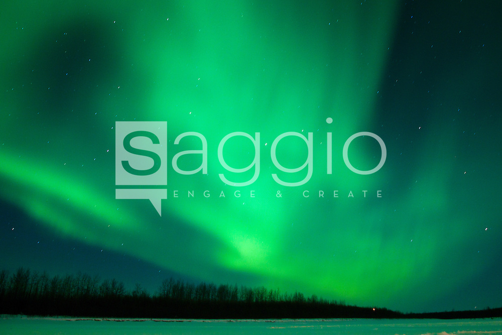 The aurora borealis shines over the Kuskokwim River near McGrath Alaska.