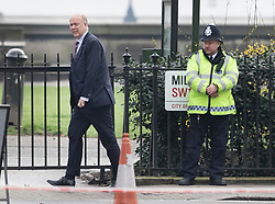 © Licensed to London News Pictures.23/03/2017.London, UK. Secretary of State for Transport Chris Grayling walks to Parliament through back streets, the day after a lone terrorist killed 4 people and injured several more, in an attack using a car and a knife. The attacker managed to gain entry to the grounds of the Houses of Parliament, killing one police officer.Photo credit: Peter Macdiarmid/LNP
