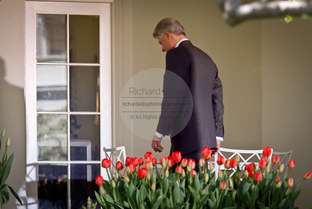 US President Bill Clinton walks to the Oval Office after making a statement on the crisis in Kosovo in the Rose Garden of the White House April 13, 1999 in Washington, DC. Clinton stated that the NATO bombing would cease when Yugoslavia withdraws their troops from Kosovo and allows the return of refugees.
