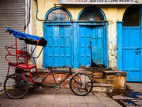 NEW DELHI, INDIA - CIRCA NOVEMBER 2018: Cycle rickshaw in the streets around the spice market and the Chandni Chowk area in Old Delhi.