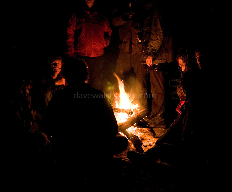 Activists warming themselves around bonfire in Upper Florentine, Tasmania during protest party.Protestors have blocked the forest access road made by contractors for Forestry Tasmania, in order to stop the logging of old growth forest in what is potentially a World Heritage Area.