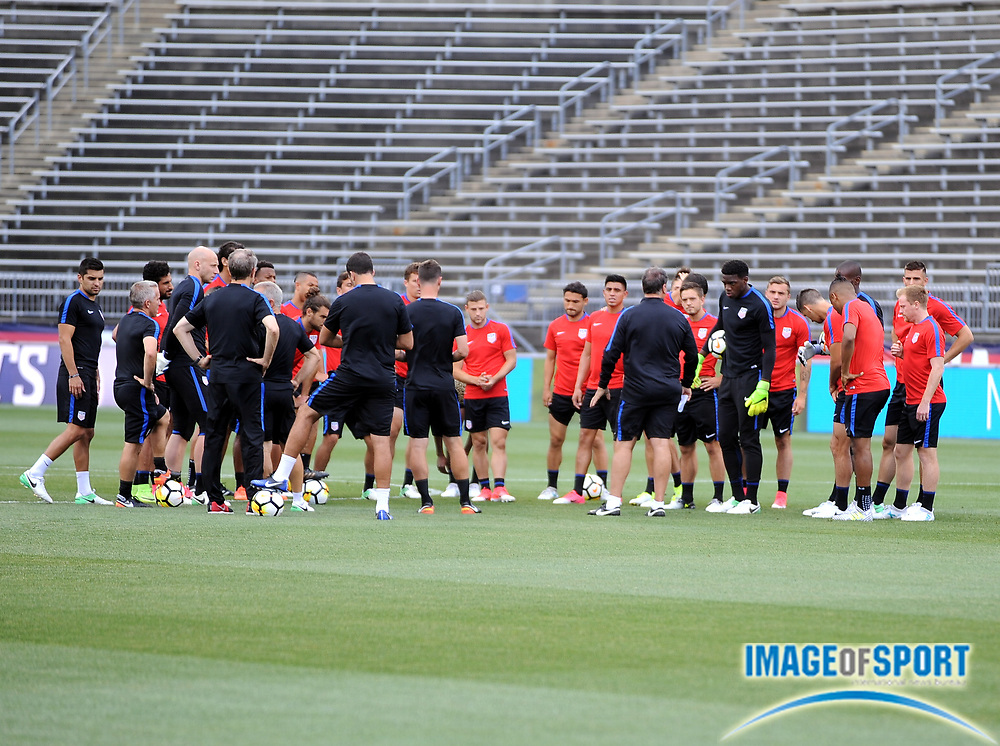 June 30, 2017; East Hartford, CT, USA;  United States coach Bruce Arena addresses the team before a training session in East Hartford, CT at Rentschler Field. Photo by Reuben Canales