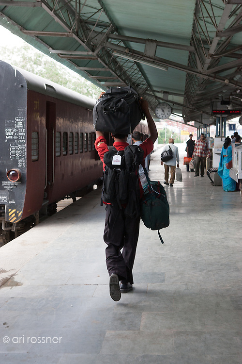 Man carrying luggage at the railway station
