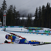 Winter Olympics, Vancouver, 2010.Dana Plotogea, Romania, feels the pain after finishing during the Women's 7.5 KM Sprint Biathlon at The Whistler Olympic Park, Whistler, during the Vancouver  Winter Olympics. 13th February 2010. Photo Tim Clayton