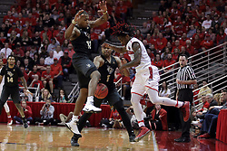 20 March 2017:  Paris Lee(1) gets doubled by Matt Williams and B.J. Taylor and tries to get out of it by bouncing the ball out using the legs of Matt Williams during a College NIT (National Invitational Tournament) 2nd round mens basketball game between the UCF (University of Central Florida) Knights and Illinois State Redbirds in  Redbird Arena, Normal IL