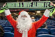 An Albion fan in Santa Claus costume during the EFL Sky Bet Championship match between Brighton and Hove Albion and Leeds United at the American Express Community Stadium, Brighton and Hove, England on 9 December 2016. Photo by Bennett Dean.