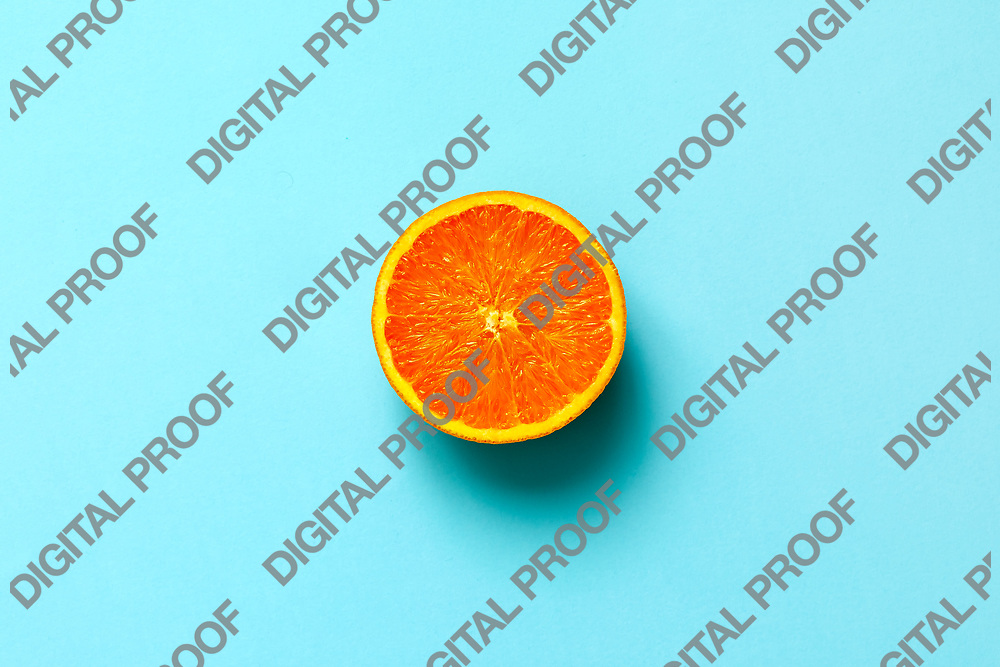 Orange fruit. Orange half fruit sliced isolate on blue background seen from above flatlay style, close up.
