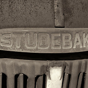 Rusted Vintage Studebaker Truck Emblem - Motor Transport Museum - Campo, CA - Sepia Black & White