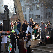 Thousands of school children went on strike and did not go to school demanding climate change action in central London March 15th 2019, Central London, United Kingdom. The strike is inspired by Greta Thunberg, a Swedish school girl who in 2018 went on school strike to make adults and lawmakers take climate change action. Youngsters hang out by the statue of Fawcett in Parliamnet Square.