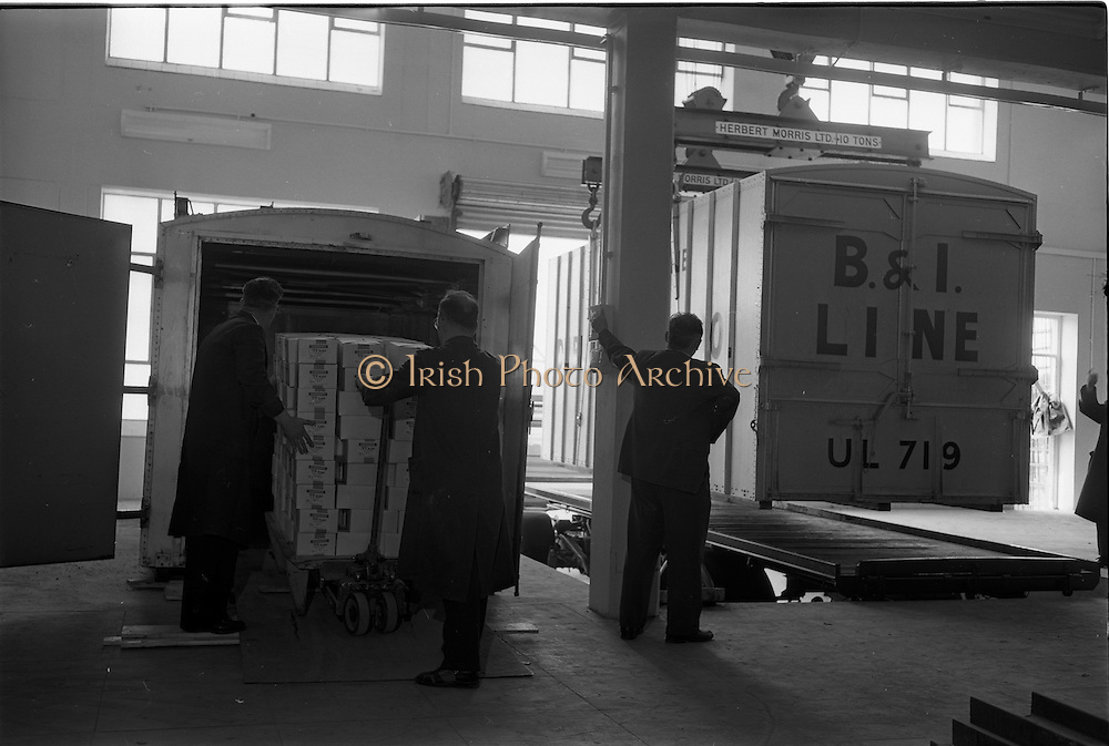 "28/05/1962<br /> 05/28/1962<br /> 28 May 1962<br /> Fry-Cadbury factory on the Malahide Road, Dublin. Picture shows the container on left being packed  with ""99"" Flakes, while container on right is lifted onto trailer for shipping."