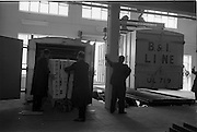 """28/05/1962<br /> 05/28/1962<br /> 28 May 1962<br /> Fry-Cadbury factory on the Malahide Road, Dublin. Picture shows the container on left being packed  with """"99"""" Flakes, while container on right is lifted onto trailer for shipping."""