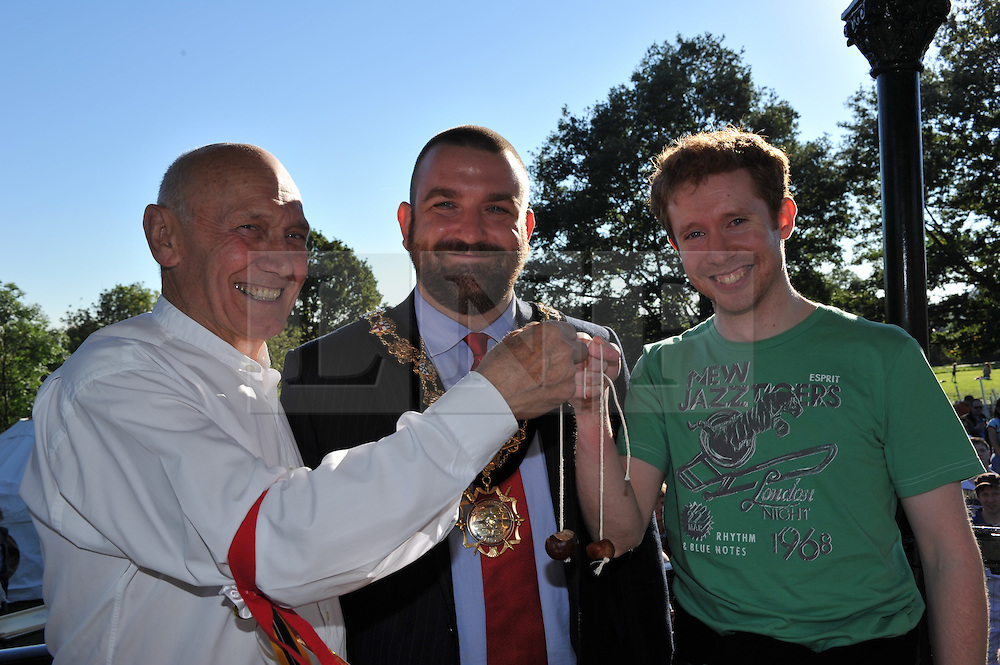 © Copyright licensed to London News Pictures. 06/10/2010. The adult finalists in the Hampstead Heath annual conker competition. L to r: last and this year's winner, John Russell, Cllr Jonathan Simpson and Mr Merrick, Parliament Hill, Hamsptead Heath, London. The Annual Heath Heritage Festival hosts the annual Hampstead Heath Conker Competition. Representatives of the RSPB, National Trust, volunteer group Heath Hands, local beekeepers and woodworkers were in attendance.