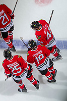 KELOWNA, CANADA - APRIL 8: Keoni Texeira #44, Evan Weinger #25, Brendan De Jong #21 and Ryan Hughes #19 of the Portland Winterhawks celebrate a third period goal against the Kelowna Rockets on April 8, 2017 at Prospera Place in Kelowna, British Columbia, Canada.  (Photo by Marissa Baecker/Shoot the Breeze)  *** Local Caption ***