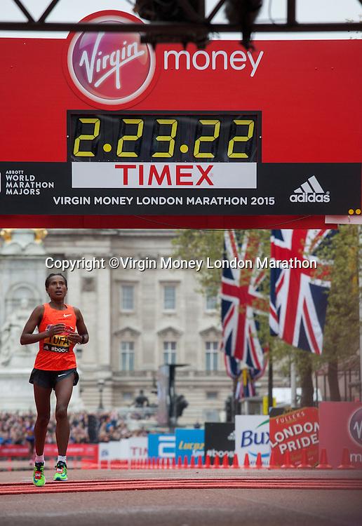 Tigist Tufa of Ethiopia crosses the line to win the Elite Womens race in The Virgin Money London Marathon, Sunday 26th April 2015.<br /> <br /> Scott Heavey for Virgin Money London Marathon<br /> <br /> For more information please contact Penny Dain at pennyd@london-marathon.co.uk