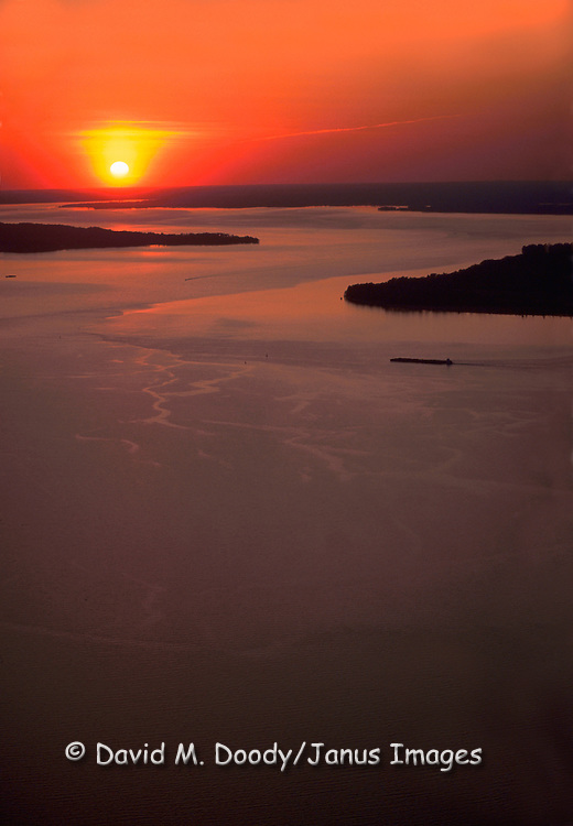 Scenic Aerial view of sunset over the lower James River at Jamestown Island (on right) , Virginia .