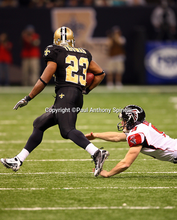 NEW ORLEANS - DECEMBER 07: Running back Pierre Thomas #23 of the New Orleans Saints steps avoids a tackle by Michael Koenen #9 of the Atlanta Falcons during an 88 yard kick return in the fourth quarter at the Louisiana Superdome on December 7, 2008 in New Orleans, Louisiana. The Saints defeated the Falcons 29-25. ©Paul Anthony Spinelli *** Local Caption *** Pierre Thomas;Michael Koenen