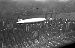 May 6, 2017 - FILE PHOTO - The Hindenburg disaster occurred on May 6, 1937, as the German passenger airship LZ 129 Hindenburg caught fire and was destroyed during its attempt to dock with its mooring mast at Naval Air Station Lakehurst in Manchester Township, New Jersey, United States. Of the 97 people on board (36 passengers and 61 crewmen), there were 35 fatalities (13 passengers and 22 crewmen). One worker on the ground was also killed, raising the final death toll to 36. Pictured: May 6, 1937 - German airship LZ 129 'Hindenburg' over New York City. (Credit Image: © German Federal Archive via ZUMA Wire/ZUMAPRESS.com)