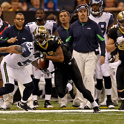 November 21, 2010; New Orleans, LA, USA; New Orleans Saints wide receiver Robert Meachem (17) runs past Seattle Seahawks linebacker Lofa Tatupu (51) during a game against the Seattle Seahawks at the Louisiana Superdome. Mandatory Credit: Derick E. Hingle