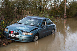 (c) Licenced to London News Pictures. 22/12/2019. Essex, UK. Flooded roads around Billericay Essex today after several flood warnings were issued. One vehicle appears to have been vandalised after being left in floodwater at Buttsbury Wash near Billericay. Photo Caption Simon Ford/LNP