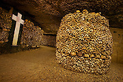 FRA_050524_026_x.Stacks of bones and skulls in the catacombs of Paris, France.  The catacombs are a vast network of tunnels and tombs below the city.  They were originally built from limestone quarries dating back to the Romans.  .