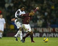 Photo: Aidan Ellis.<br /> Bolton Wanderers v Arsenal. The Barclays Premiership.<br /> 03/12/2005.<br /> Arsenal's Thierry Henry holds off Bolton's Ricardo Gardener