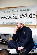 Dietzenbach | 24.07.2011..Am Samstag (24.07.2011) hielt der Salafist und radikale Islamist Pierre Vogel (Abu Hamza) in Dietzenbach (Landkreis Offenbach) vor etwa 200 Menschen einen Vortrag..Hier: Pierre Vogel (Abu Hamza) waehrend des Vortrages des Islamisten Sven Lau (Abu Adam), im Hintergrund ein Werbetransparet fuer das islamische Internet-Auktionsportal Selisha...©peter-juelich.com..[No Model Release | No Property Release]