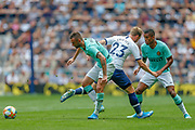 Tottenham Hotspur midfielder Christian Eriksen (23) tackled by Inter Milan midfielder Marcelo Brozovic (77) during the Pre-Season Friendly match between Tottenham Hotspur and Inter Milan at Tottenham Hotspur Stadium, London, United Kingdom on 4 August 2019.