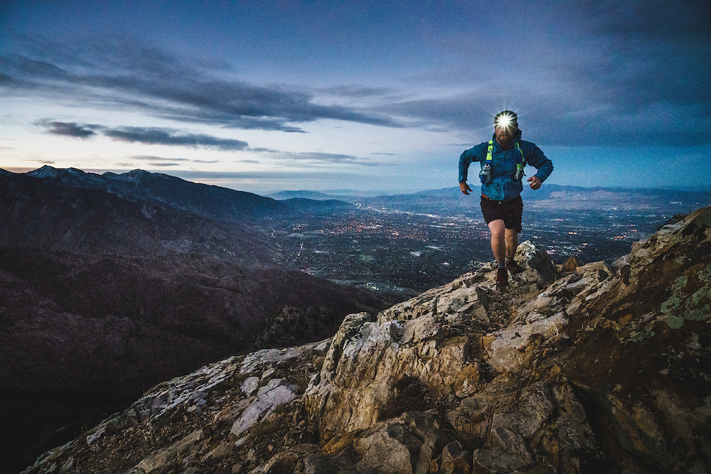 Jeremy Howlett scrambles to the summit of Mount Olympus during a predawn run, Wasatch Mountains, Utah.