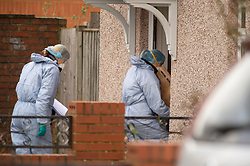 ©Licensed to London News Pictures 26/02/2020<br /> Croydon, UK. Forensics going into a house. A 24 year old man has been stabbed to death in Croydon, South East London over night. Police were called to the scene at 12.15am. The man was pronounced dead at the scene no arrests have been made. A police cordon is in place with forensic officers coming and going to a nearby property. Photo credit: Grant Falvey/LNP
