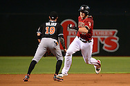 PHOENIX, AZ - JUNE 12:  Nick Ahmed #13 of the Arizona Diamondbacks runs by Miguel Rojas #19 of the Miami Marlins to reach it safely to third base in the first inning at Chase Field on June 12, 2016 in Phoenix, Arizona.  (Photo by Jennifer Stewart/Getty Images)