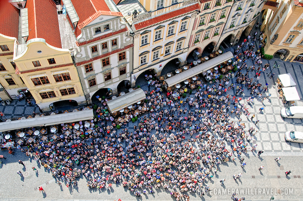 Aerial view of crowds of tourists watching the historical Astronomical Clock chiming on the hour