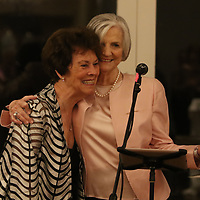 Lucy Gaines hugs Nancy Diffee after surprising her with the Gum Tree Art Museum Nancy Diffee Endowment Fund for Exhibitions through Create