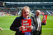 MK Dons Chairman Pete Winkleman shows racism a red card during the Sky Bet Championship match between Milton Keynes Dons and Nottingham Forest at stadium:mk, Milton Keynes, England on 7 May 2016. Photo by Dennis Goodwin.
