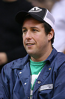 28 December 2005: Comedian Adam Sandler enjoys the game between the Los Angeles Lakers and the Memphis Grizzlies during the Grizzlies 100-99 victory over the Lakers at the STAPLES Center in Los Angeles, CA.