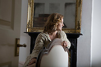 Young woman leaning on chair