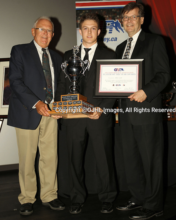 TORONTO, ON - Jun 5, 2015 : Ontario Hockey Association 2014-2015 Awards from the Hockey Hall of Fame in Toronto, Ontario Canada. Larry Kennan and GOJHL Convenor Chuck Williams co present the Player of the Year Award in the Junior &quot;B&quot; Category, Chris Scott of the Leamington Flyers Hockey Club.<br /> (Photo by Tim Bates / OJHL Images)
