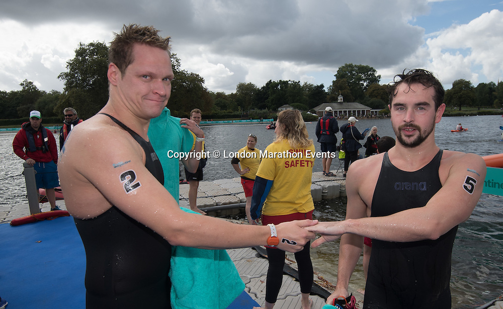 (2) Andreas Waschburger winner in the Elite Mens Race and Tom Allen (5) from the British Open Water Swimming Championships part of Swim Serpentine where thousands of swimmers take part in a two-day open water swimming festival, Swim Serpentine is held on the iconic Lake Serpentine, Hyde Park, venue for the open water swimming at London 2012.<br /> <br /> Photo: Bob Martin for Swim Serpentine<br /> <br /> For more information please contact media@londonmarathonevents.co.uk