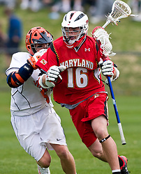Maryland Terrapins SSM Dean Hart (16) in action against UVA.  The #9 ranked Maryland Terrapins fell to the #1 ranked Virginia Cavaliers 10 in 7 overtimes in Men's NCAA Lacrosse at Klockner Stadium on the Grounds of the University of Virginia in Charlottesville, VA on March 28, 2009.