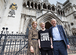 © Licensed to London News Pictures. 20/06/2017. London, UK. Actress JULIET STEVENSON (L), STELLA CREASY MP (C) and Lord ALF DUBS (R) stand for a photograph outside the Royal Courts of Justice ahead of a court case in which refugee charities will challenge the Home Office to reopen the Dubs Amendment scheme which enabled the transfer of unaccompanied refugee children from Europe to the United Kingdom. The scheme was expected to facilitate the transfer of 3,000 child refugees but was shut down by the Home Office after approximately 350. Photo credit: Rob Pinney/LNP
