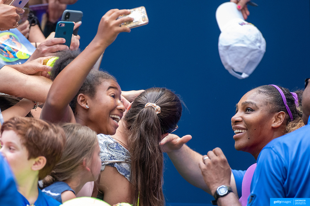 2019 US Open Tennis Tournament- Day Five.  A young fan takes a selfie with Serena Williams of the United States as she signs autographs after her win against Carolina Muchova of the Czech Republic in the Women's Singles Round Three match on Arthur Ashe Stadium at the 2019 US Open Tennis Tournament at the USTA Billie Jean King National Tennis Center on August 30th, 2019 in Flushing, Queens, New York City.  (Photo by Tim Clayton/Corbis via Getty Images)