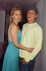 MISS MICKEY SUMNER daughter of singer Sting and MR BEN TOWILL at the launch of Friday Nights at Mamilanji - Chelsea's newest and most exclusive members club, 107 Kings Road, London SW3 hosted by Charlie Gilkes and Duncan Stirling held on 29th July 2005.<br />