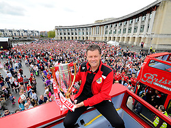 Bristol City manager, Steve Cotterill holds the Sky Bet League one Trophy on the bus,  in front of thousands of fans gathered at the amphitheatre in Bristol  - Photo mandatory by-line: Joe Meredith/JMP - Mobile: 07966 386802 - 04/05/2015 - SPORT - Football - Bristol -  - Bristol City Celebration Tour